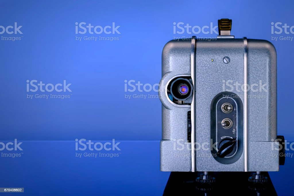 Old cinema projector in a metal case with a burning lamp stock photo