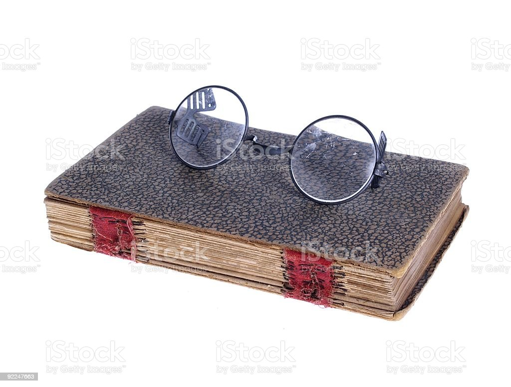 Old Circular Glasses on Ancient Book royalty-free stock photo