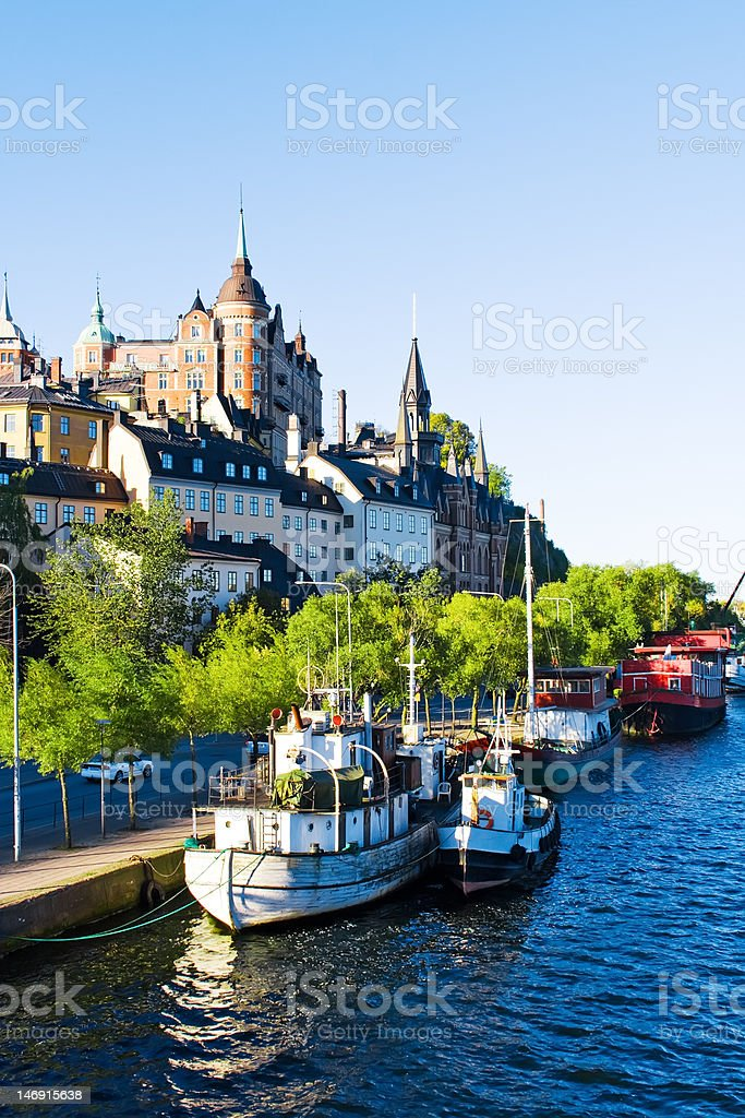 Old city buildings and boats on water stock photo