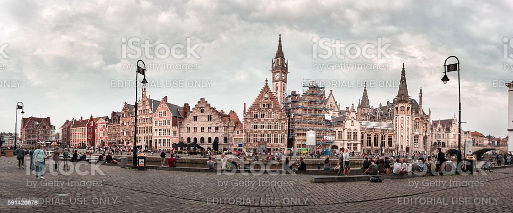 Old city of Ghent with resting people on the quay stock photo