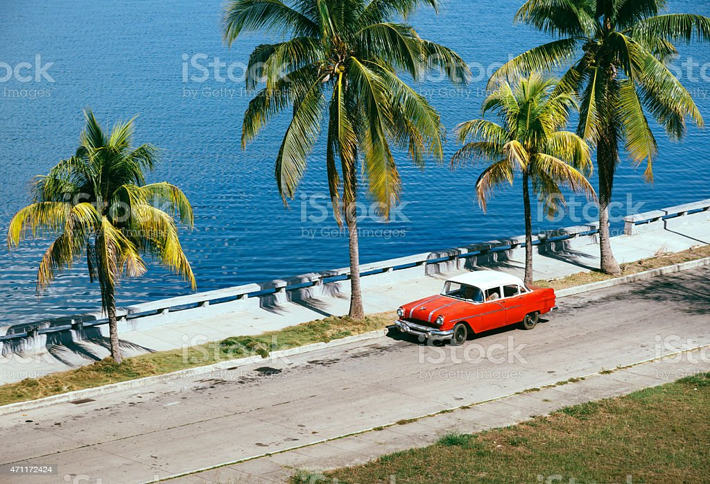 Old classic car near the beach, Cuba stock photo