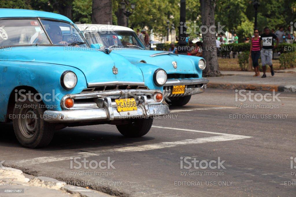 Old Classic Cars Passing Through Havanas Reina Street stock photo ...