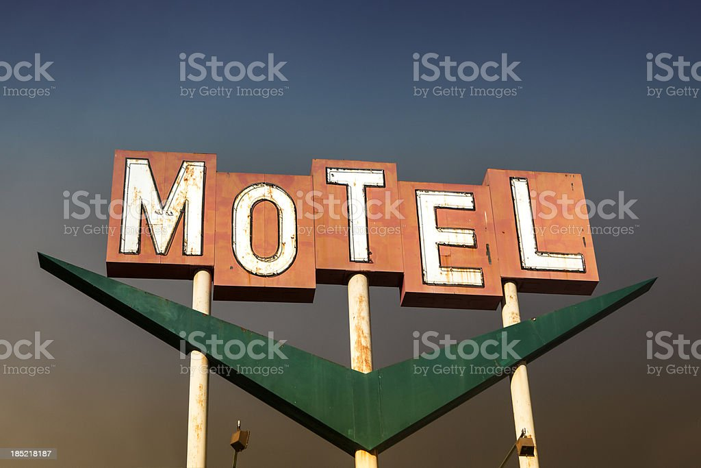 Old classic motel sign off the freeway stock photo