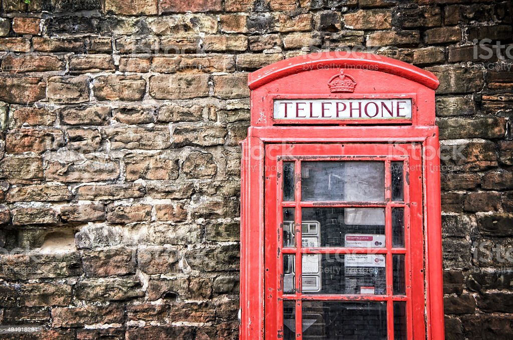 Old classic red telephone booth stock photo