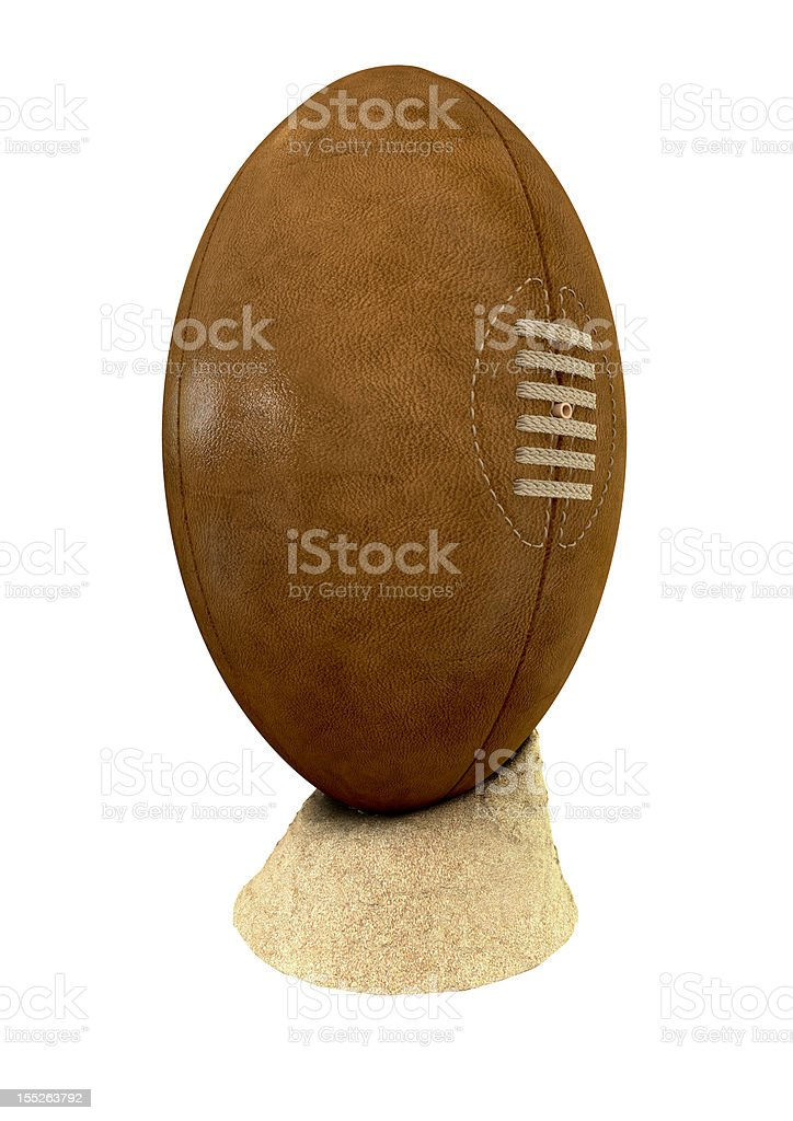 Old Classic Retro Rugby Ball On Sand stock photo