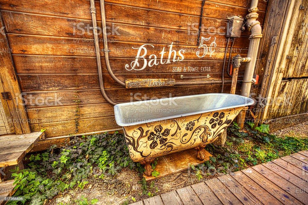 Old Clawfoot Bathtub In The Town Of Locke stock photo