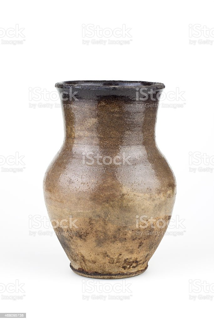 old clay jug isolated stock photo