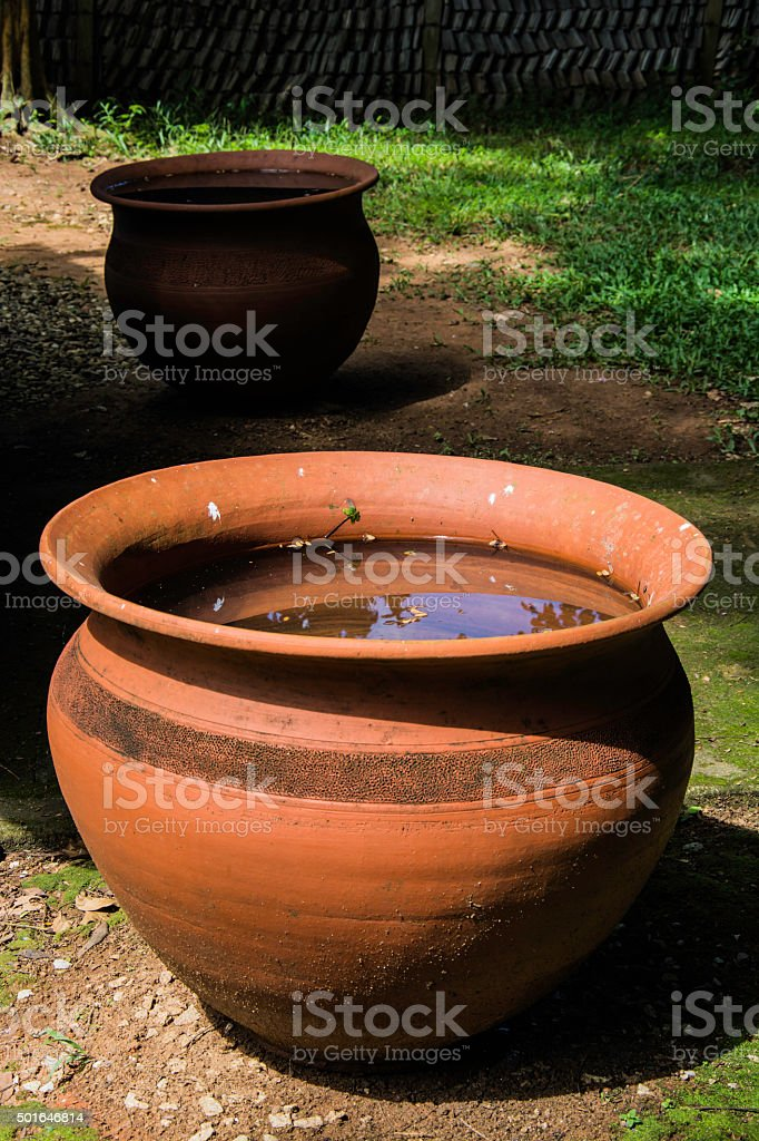 Old clay pots with water royalty-free stock photo