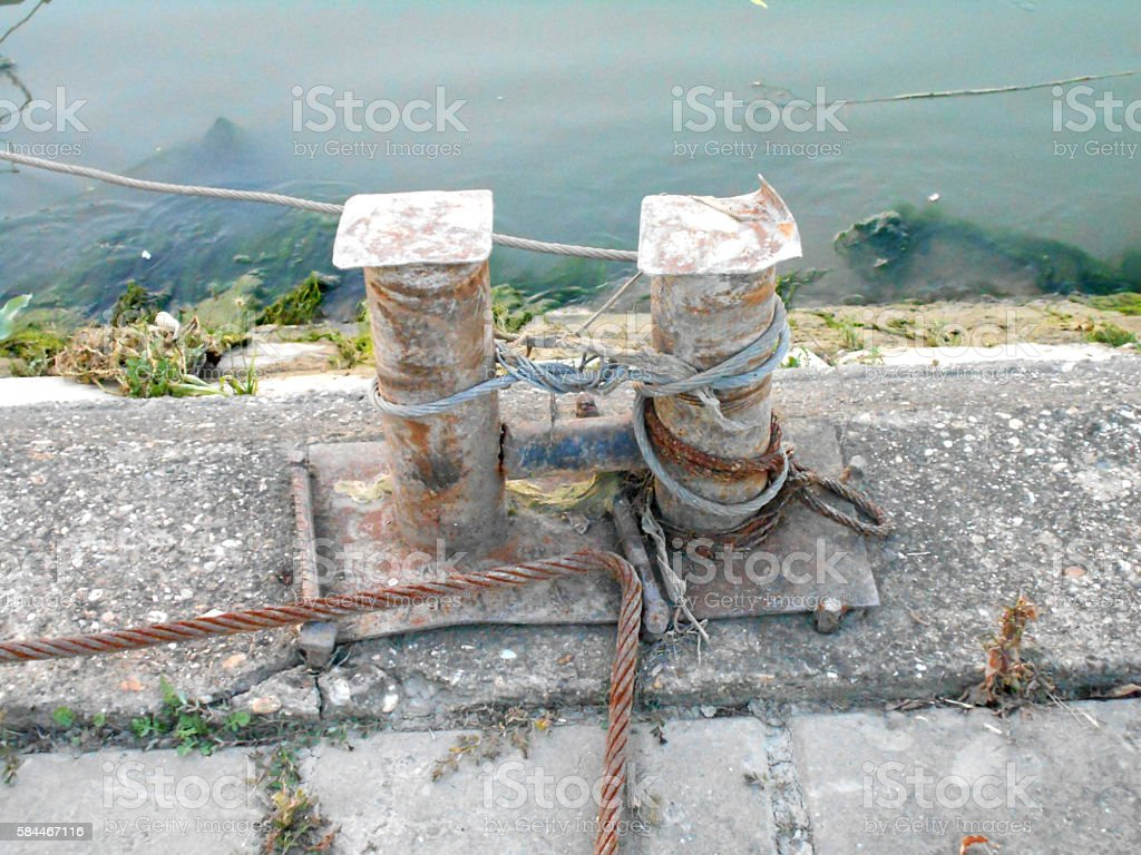 Old cleats on the old dock stock photo