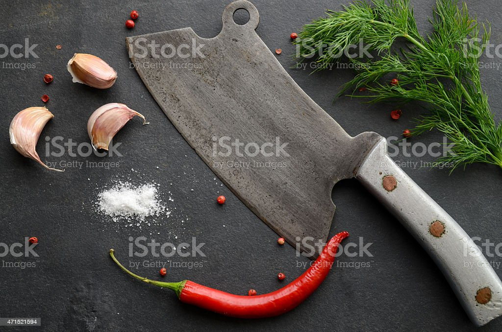 Old cleaver with herbs and spices stock photo
