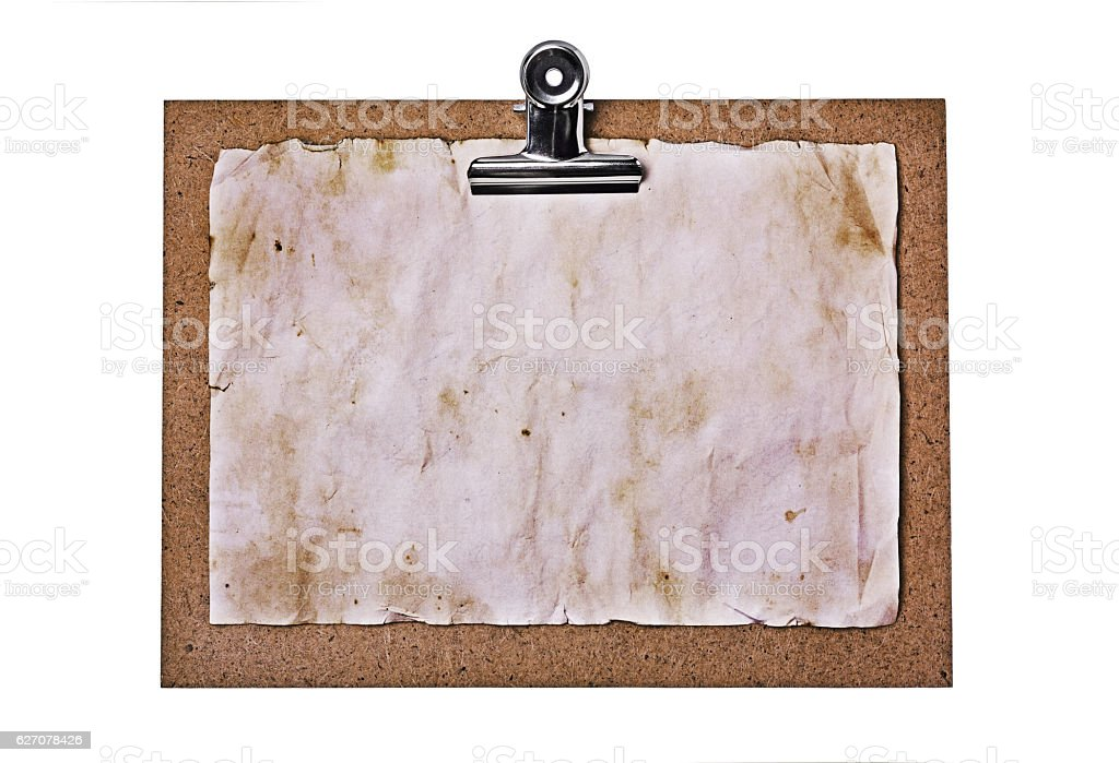 Old clipboard and grunge paper sheet stock photo