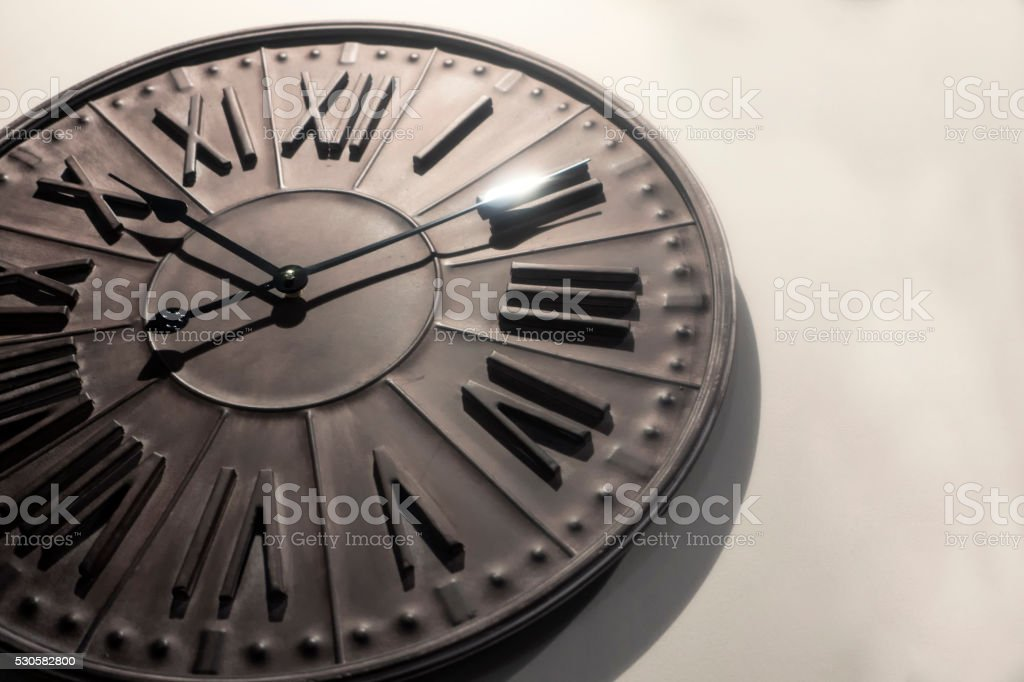 Old clock isolated on white background stock photo