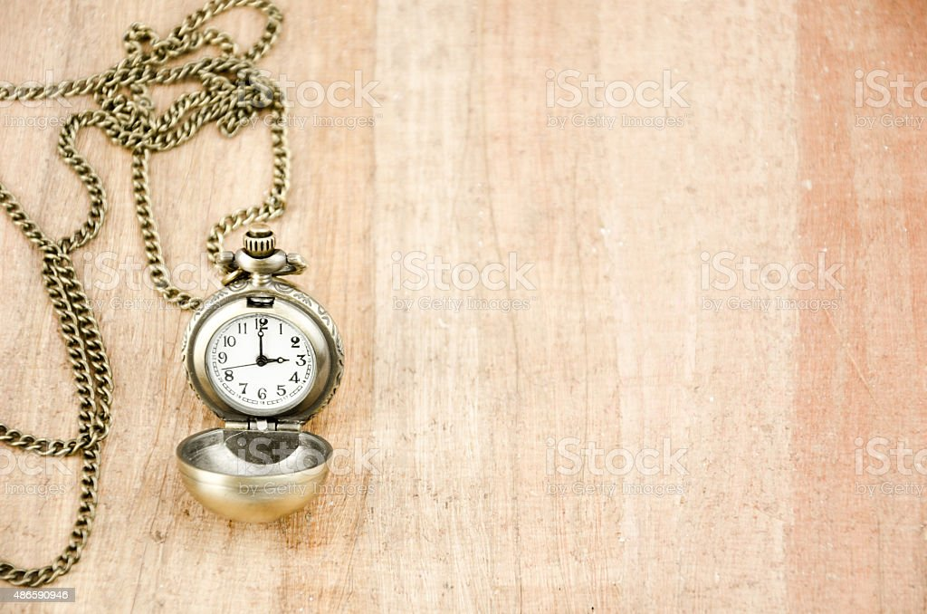 Old clock on papyrus stock photo