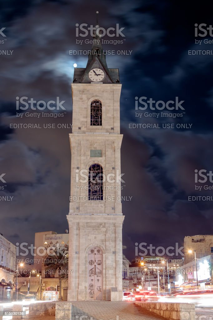 Old Clock Tower at night in old city Yafo, Israel. It's limestone clock tower built in 1903 to honor one of the last sultans of the Ottoman Empire. stock photo