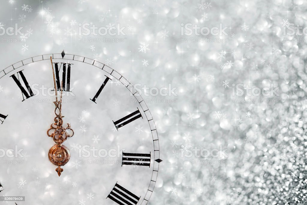Old clock with stars snowflakes and holiday lights stock photo