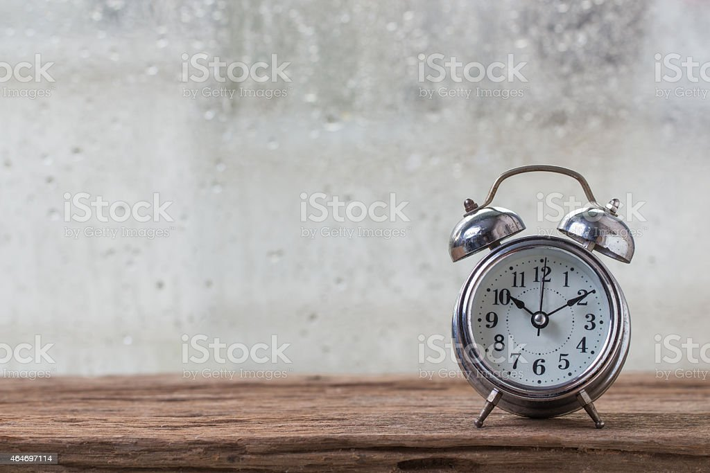 Old clock with the rain stock photo