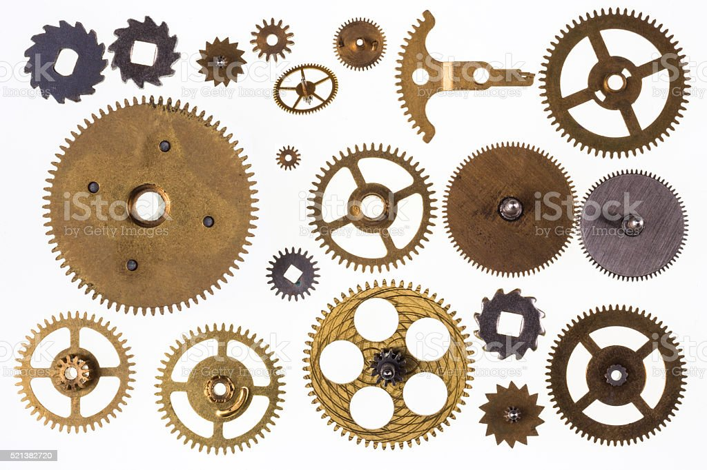 Old clockwork cogs and clock parts - Isolated stock photo