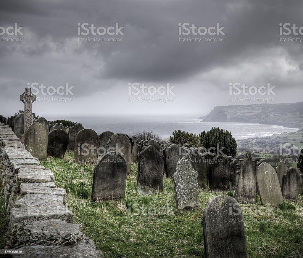 Old coastal churchyard and gravestones, Yorkshire, UK stock photo