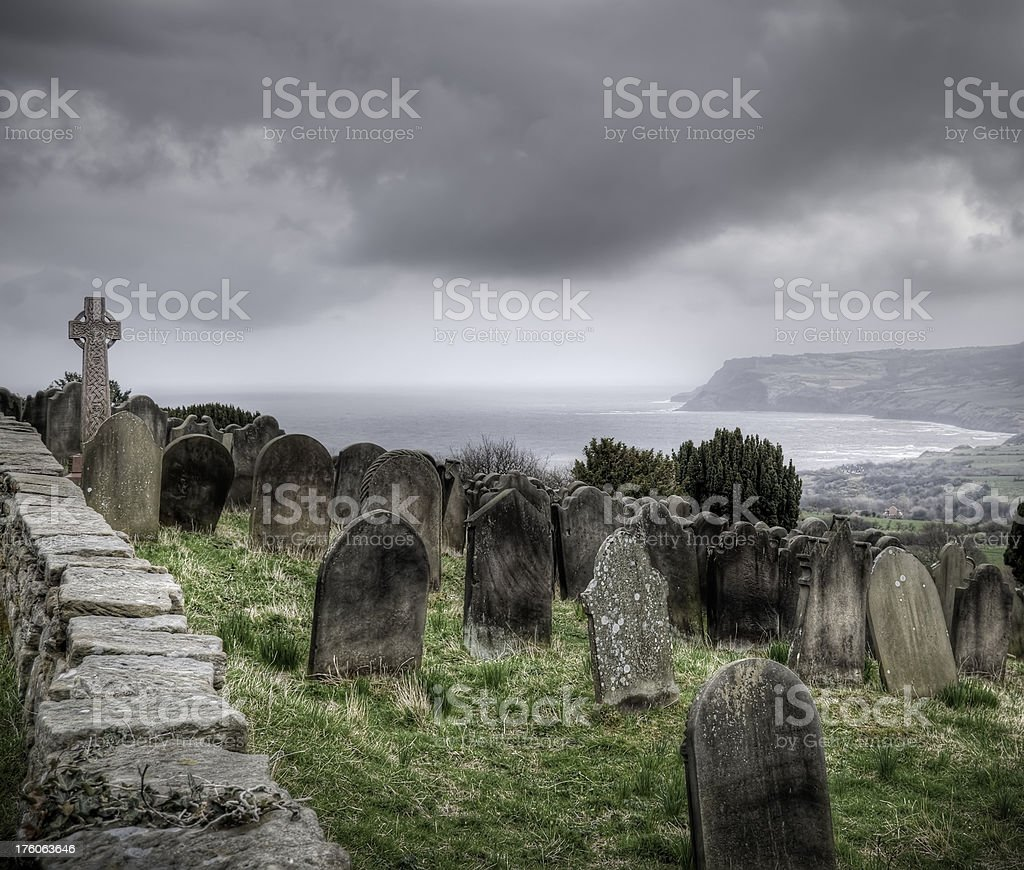 Old coastal churchyard and gravestones, Yorkshire, UK stock photo