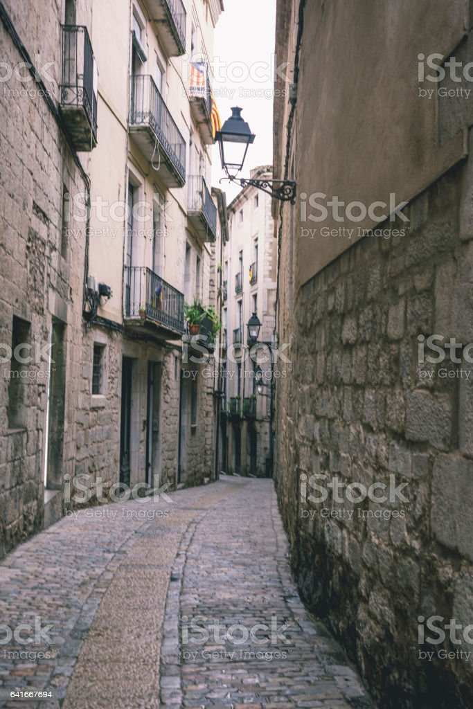 Old cobble stones narrow street stock photo