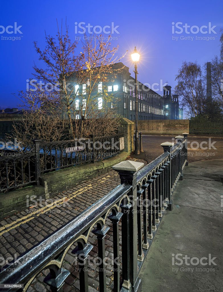 Old cobbled streets and Salt's Mill in Saltaire, Bradford stock photo
