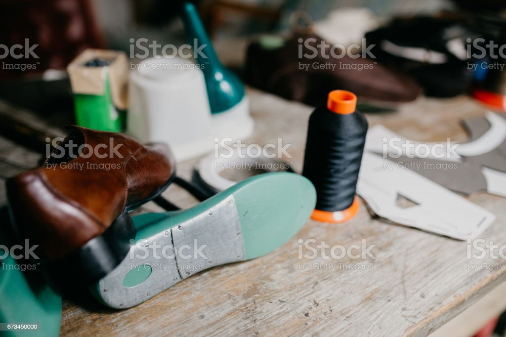 Old cobbler workshop with tools and spare parts stock photo
