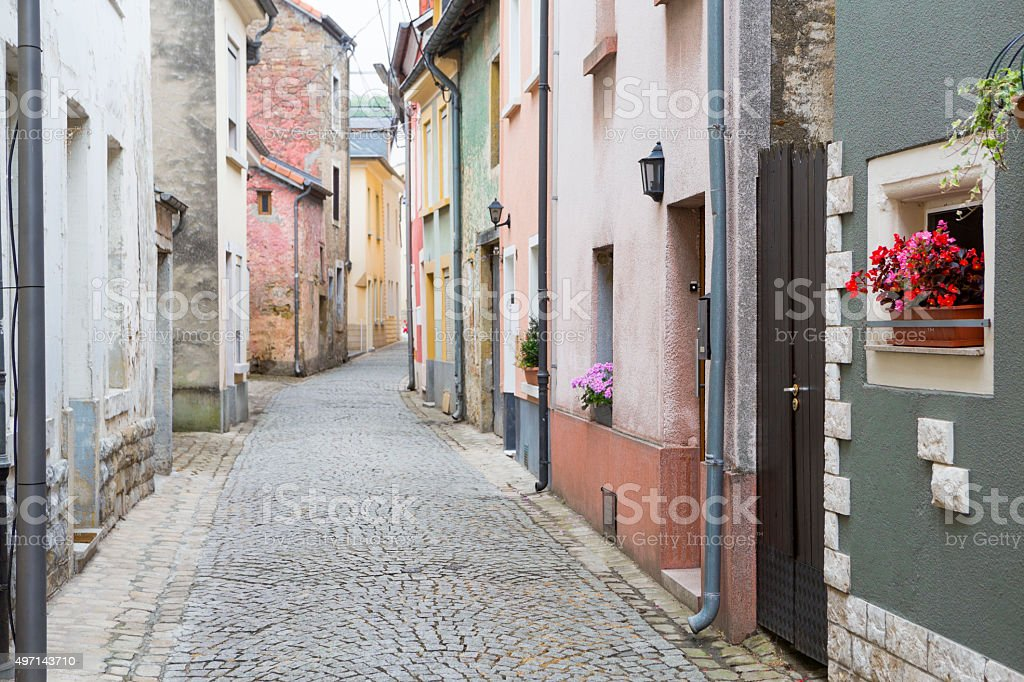 Old cobblestone street with stucco buildings in Luxembourg, Europe stock photo