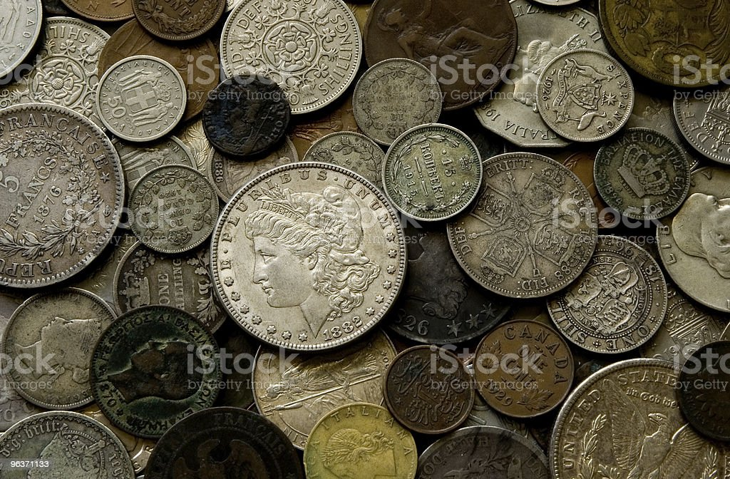 Vecchie monete dei paesi diversi foto stock royalty-free