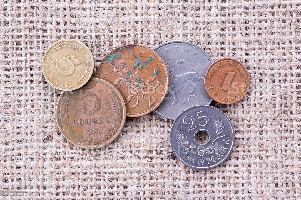 Old coins on burlap stock photo