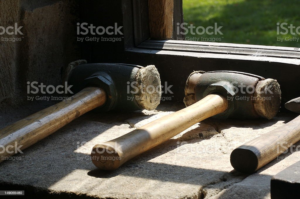 Old, colonial leather Hammers for Barrel making and casking whiskey royalty-free stock photo