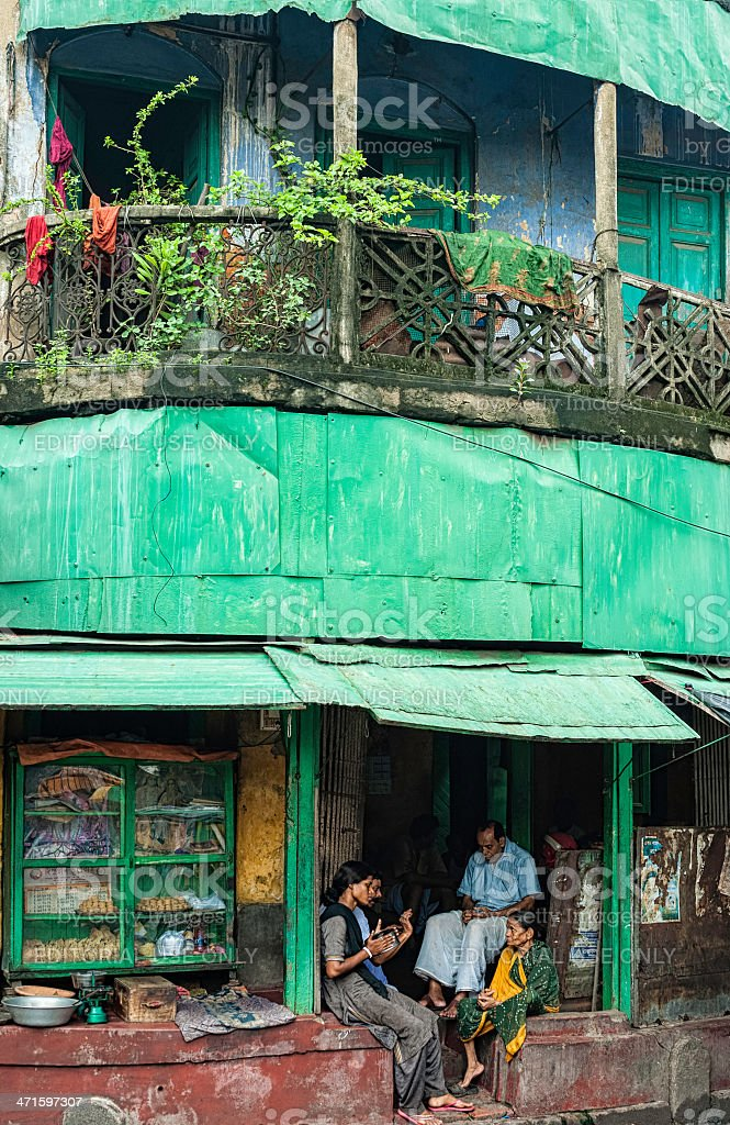 Old colonial terrace house and shop, Kalighat, Kolkata, India. stock photo