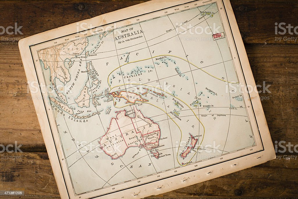 Old, Color Map of Australia, Sitting on Wood Trunk stock photo