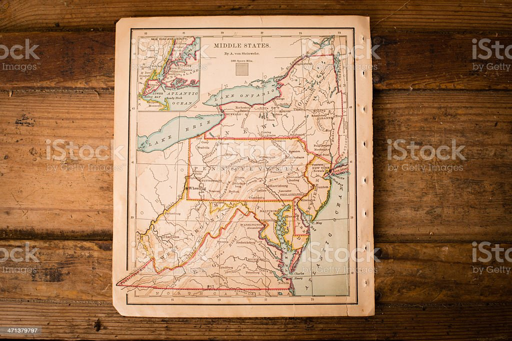 Old, Color Map of Middle States, Sitting on Wood Trunk stock photo
