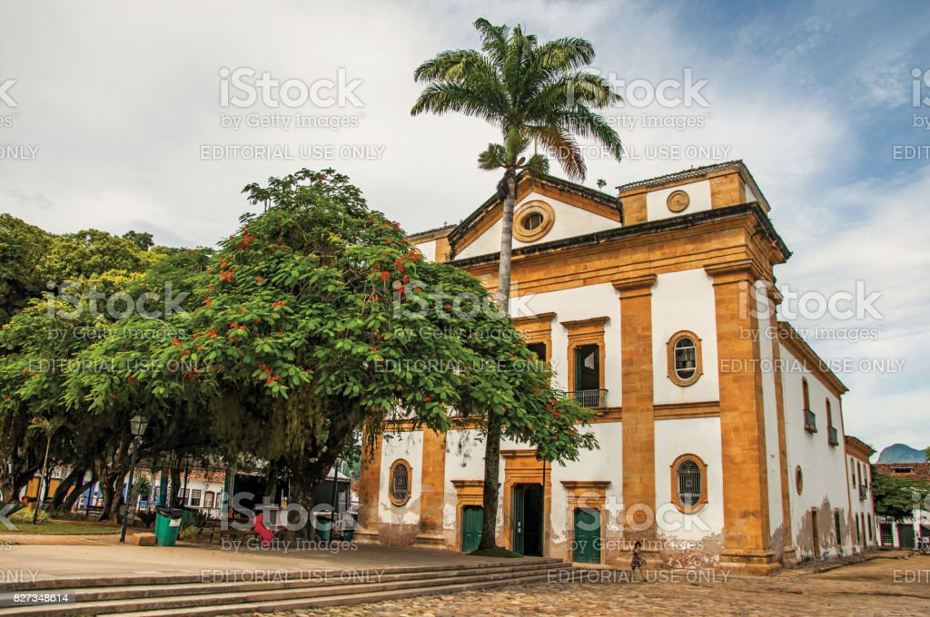 Old colored church, garden and cobblestone street in Paraty. stock photo