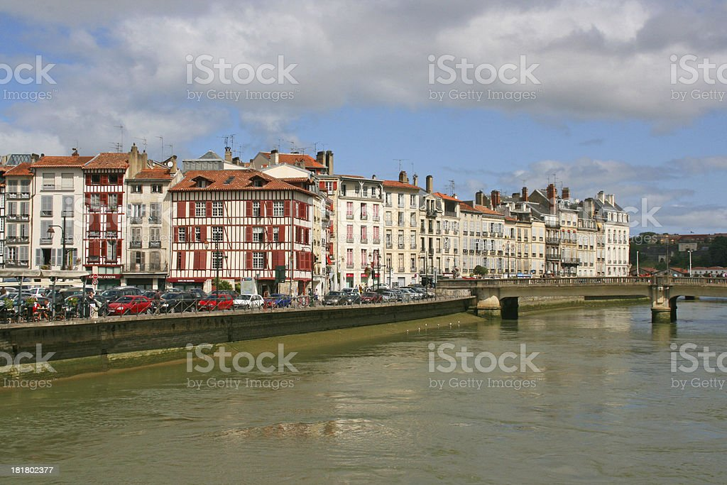 Old colored houses overlooking the river Nive in Bayonne, France. stock photo
