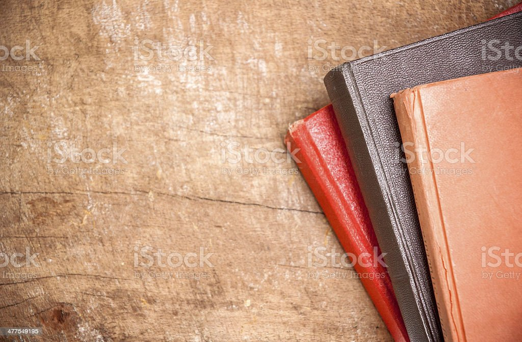 Old colorful books on wooden board stock photo
