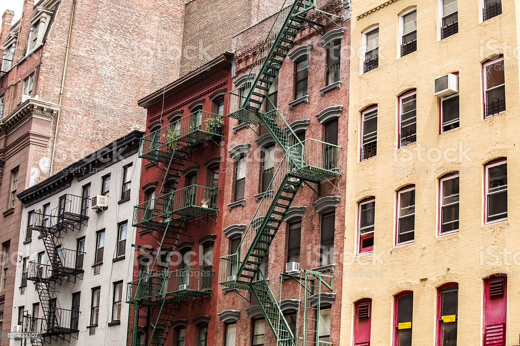 Old colorful buildings with fire escape, New York City, USA stock photo