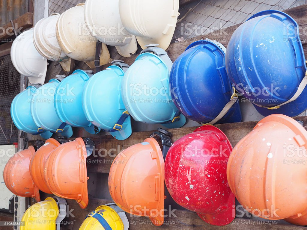 old colorful construction helmets stock photo