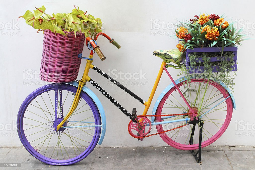 Old colourful bike with flowers stock photo