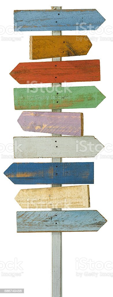 Old colourful weathered wood arrow signboards pointing in opposite directions. stock photo