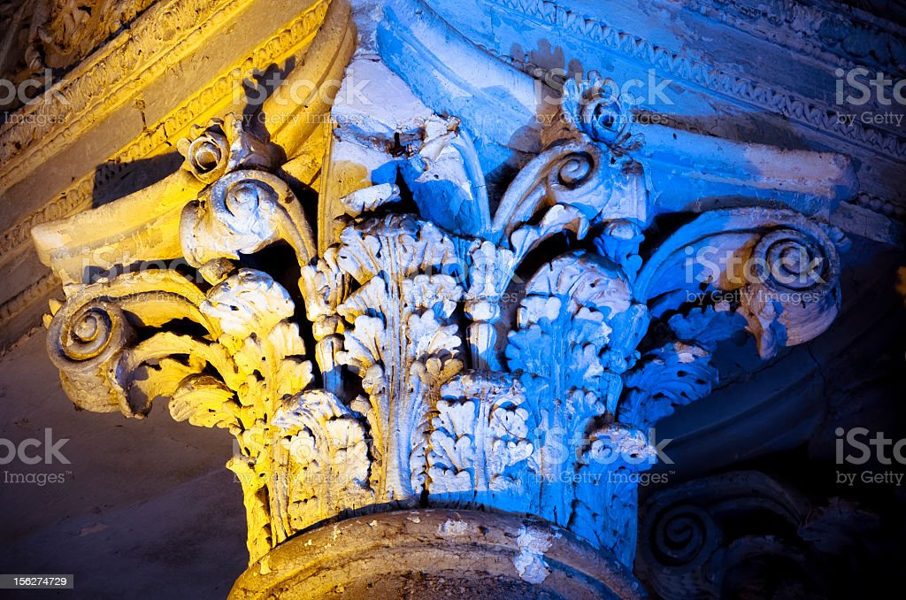 Old column capital in abandoned church royalty-free stock photo
