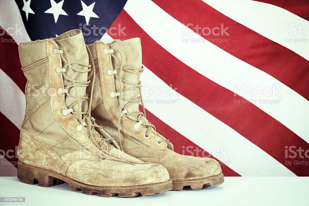 Old combat boots with American flag stock photo