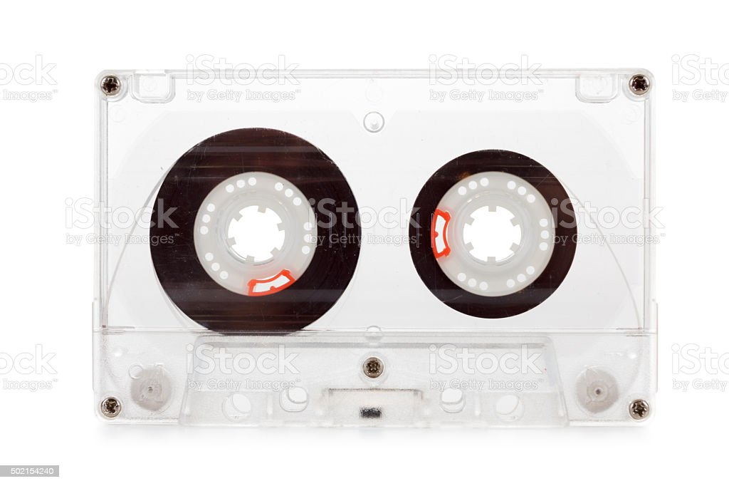 Old compact audio cassette, macro shot on white background, empty stock photo