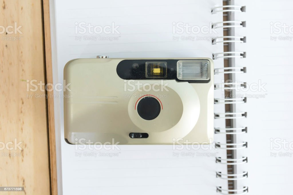 Old compact camera on book stock photo