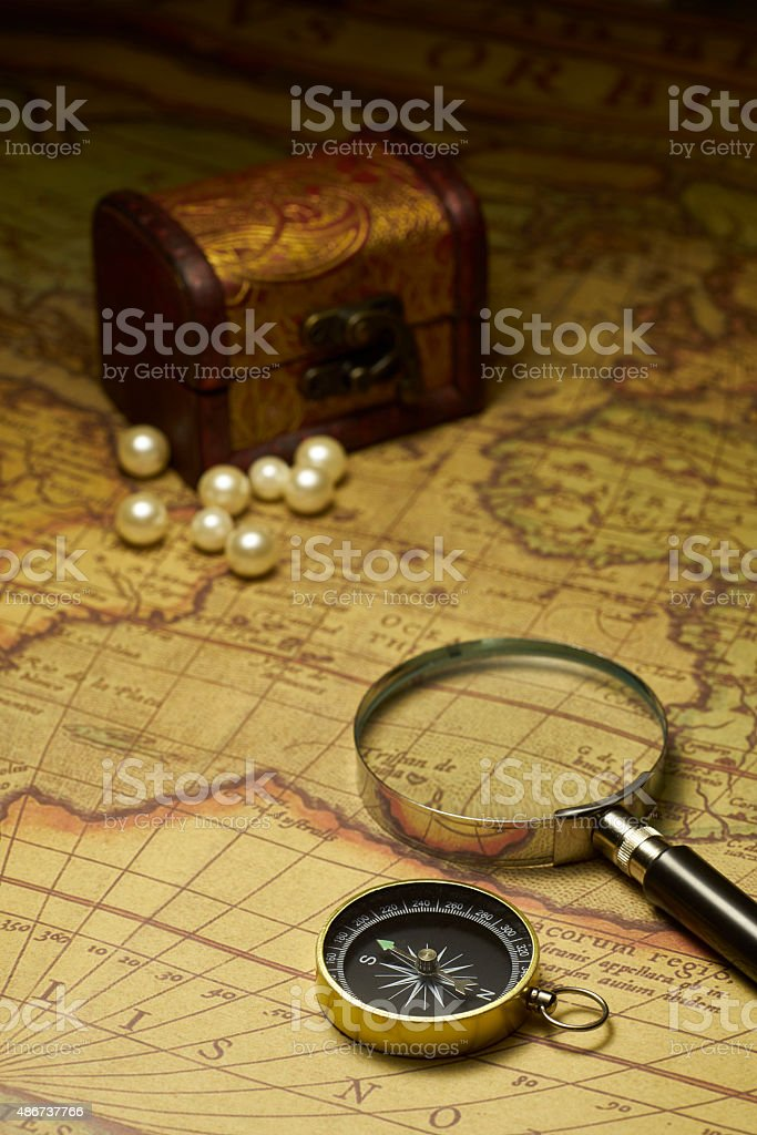 Old compass and Magnifier on vintage map stock photo