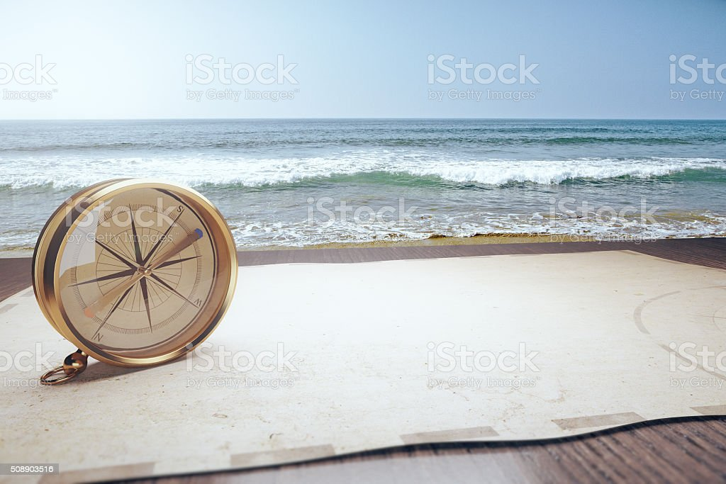Old compass and map and ocean waves stock photo