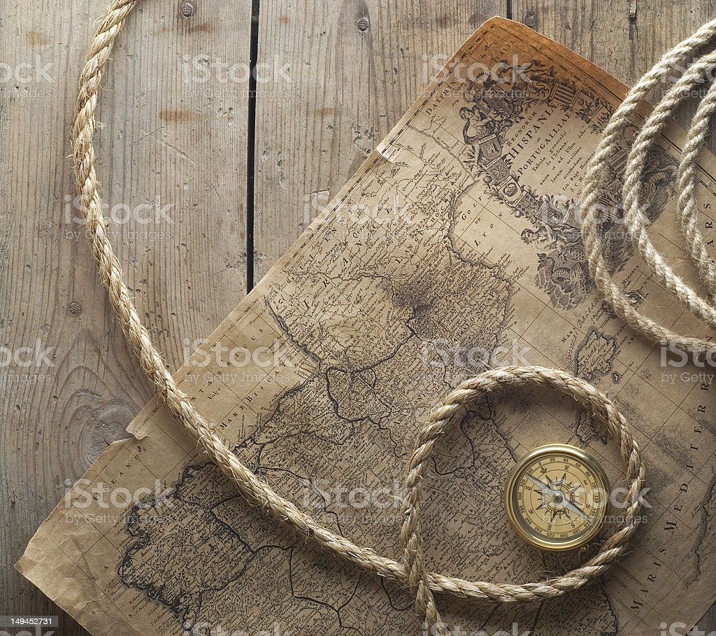 old compass and rope on vintage map 1732 royalty-free stock photo