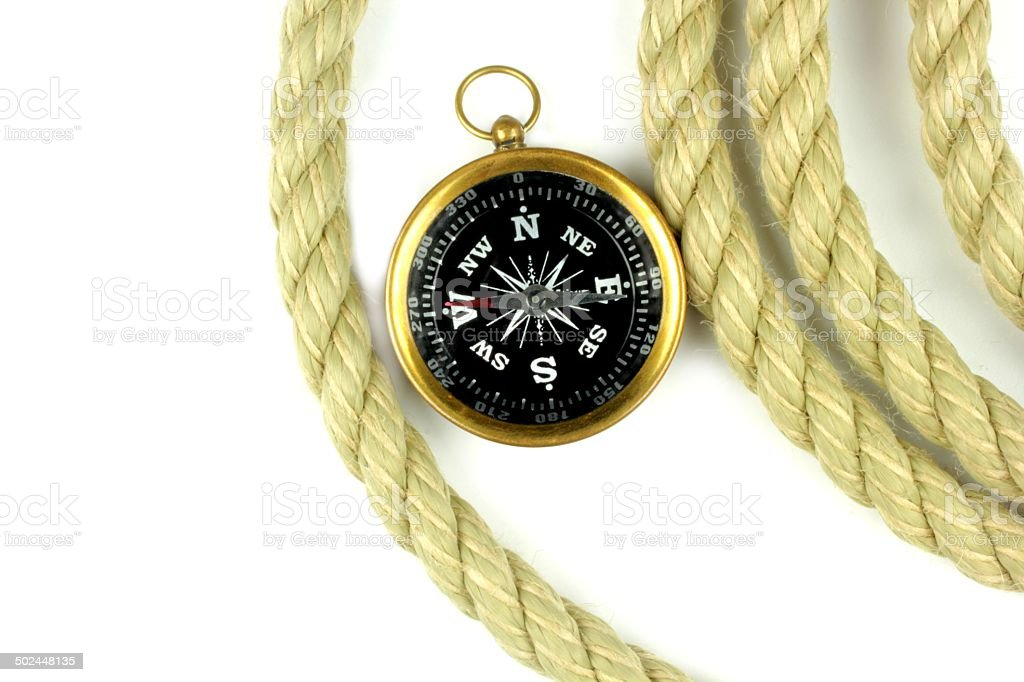 Old compass and rope on white background. stock photo