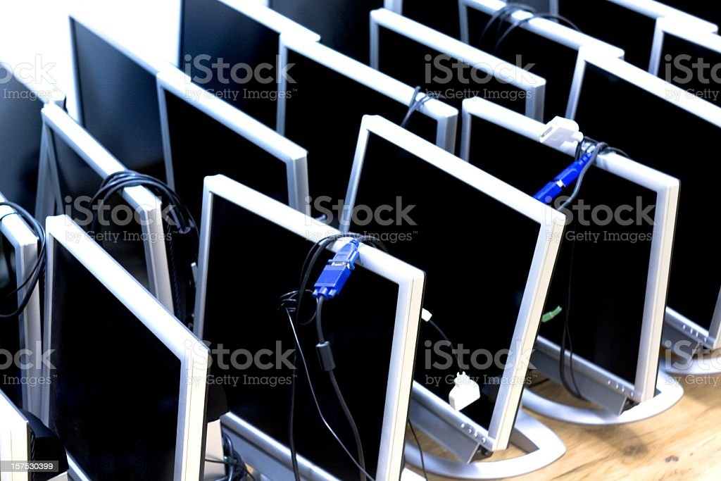 Old Computer monitors in a row stock photo