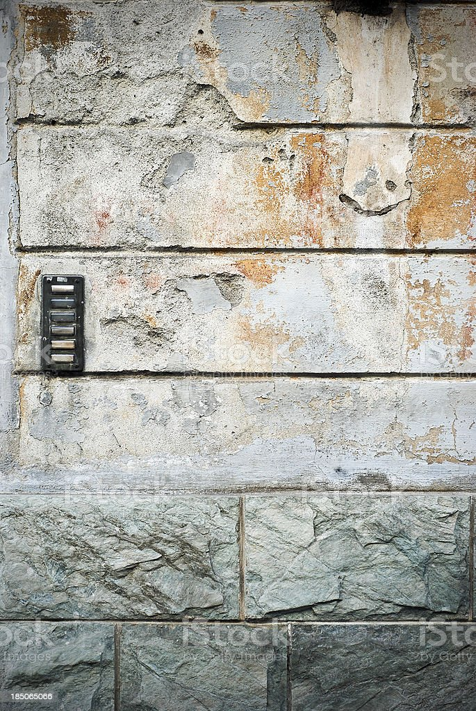 Old concrete and stone wall with intercom royalty-free stock photo